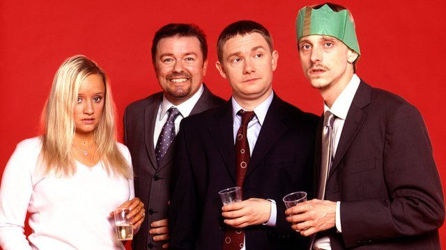 Characters from BBC's The Office at a Christmas party