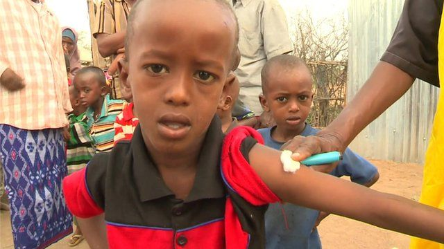 A young boy is given a vaccine in the Dadaab refugee camp in Kenya