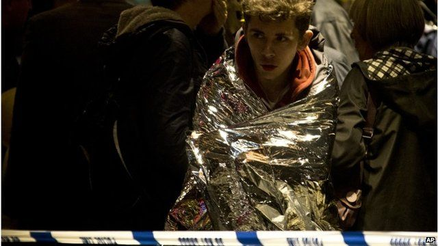 Man wrapped in foil blanket