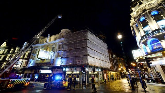 Members of the emergency services work at the scene of a roof collapse at The Apollo Theatre