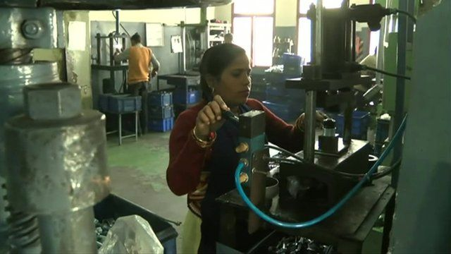 A worker in a car manufacturing plant in India