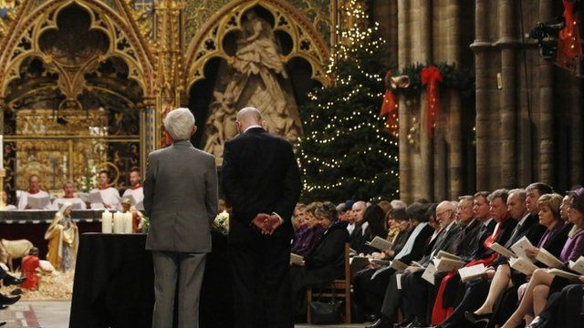 Relatives Jim Swire (L) and William Swire pause after laying a wreath for the victims of the Lockerbie bombing during a service of remembrance to mark the 25th anniversary of the Lockerbie air disaster at Westminster Abbey