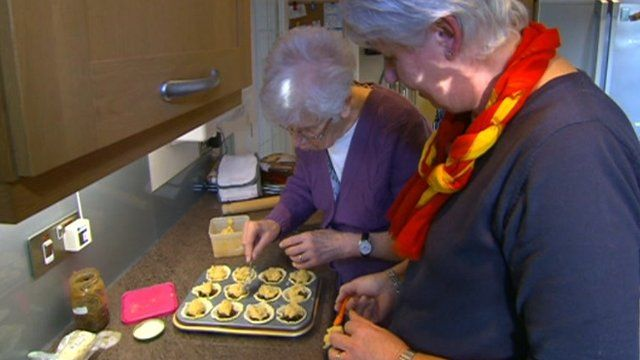 Two women baking