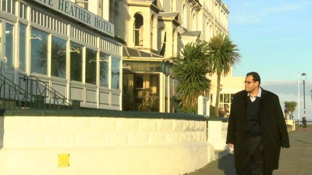 Egyptian businessman walking in Wales