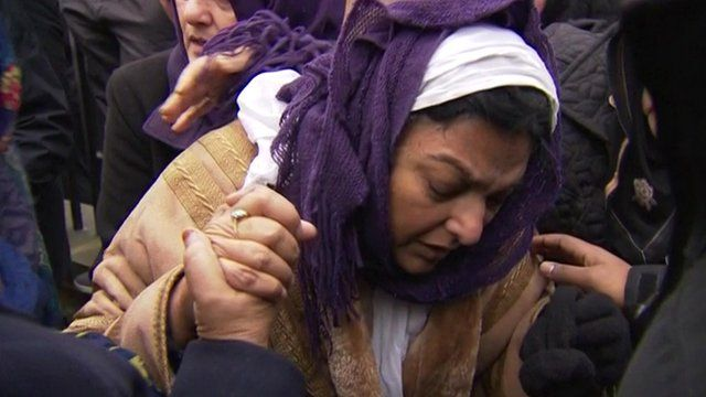 Fatima Khan surrounded by mourners