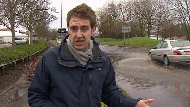 Nick Beake by flooded road in Byfleet