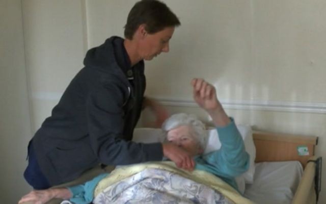 A resident in bed at the Grange Nursing Home in Sherborne St John