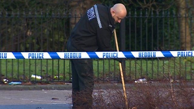 Police officer searches grass