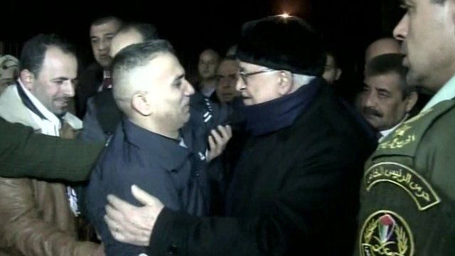 Mahmoud Abbas greets a prisoner