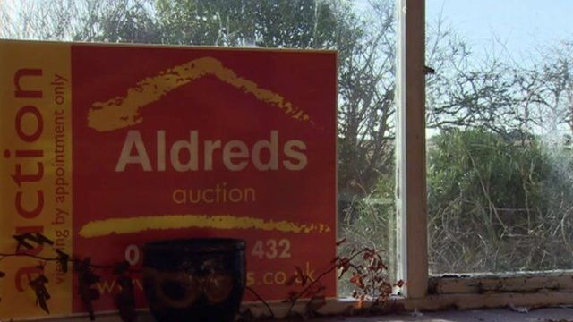 Auction sign in a window