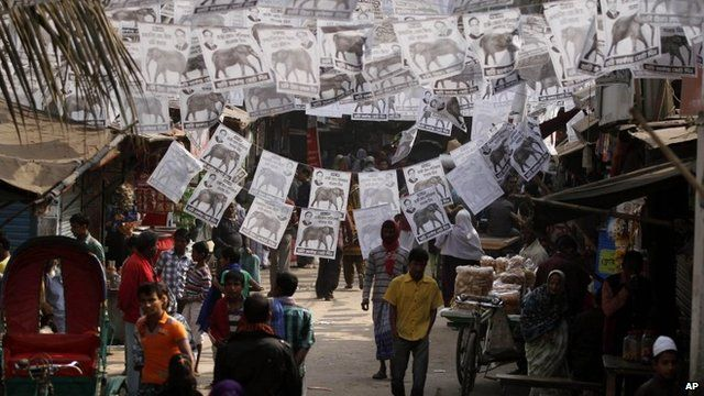 People walking under election posters