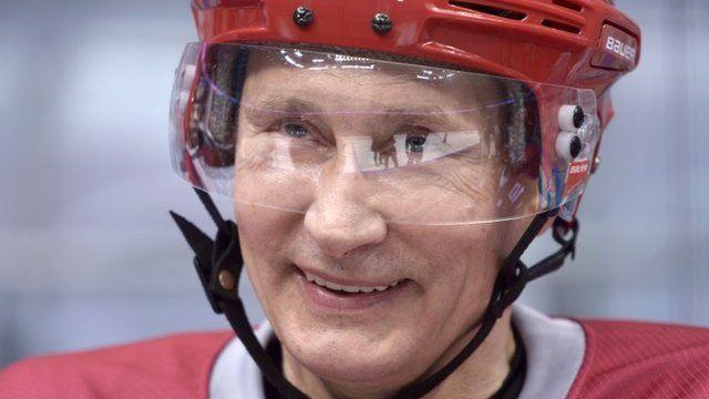 Vladimir Putin wearing an ice hockey helmet