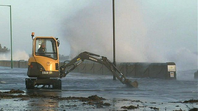 Castletown Promenade flooded during high tide
