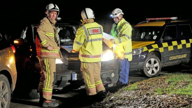 Emergency services attend the site of a helicopter crash in Cley next the Sea in north Norfolk