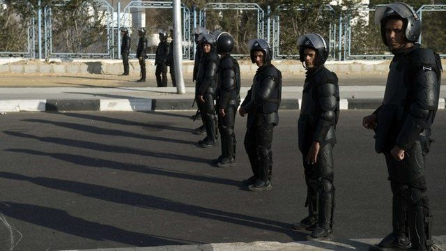 Riot police line up outside the police academy in Cairo