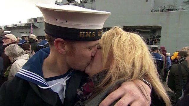 Couple kiss as HMS Illustrious returns to Portsmouth