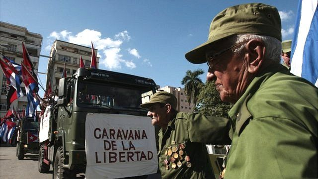 Veterans participate in a re-enactment of the 1959 march into Havana by Fidel Castro