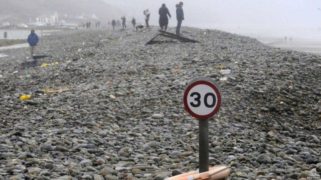 In Pembrokeshire, the main road at Newgale has been closed due to flooding - and this road sign looks lost