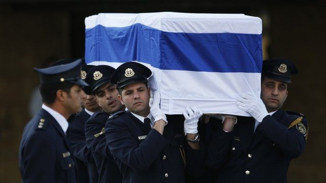 Members of the Knesset guard carry the coffin of Ariel Sharon