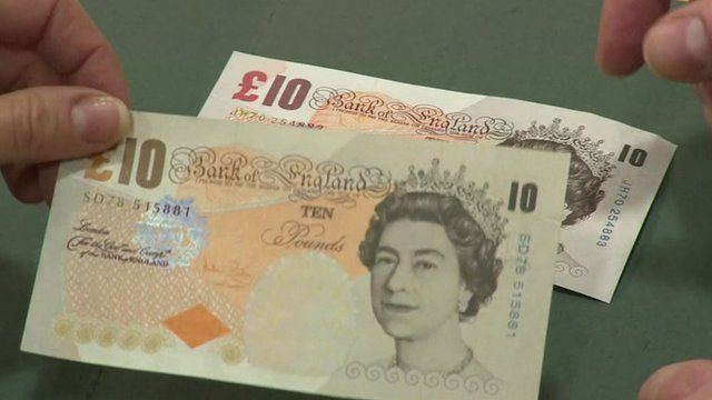 A counterfeit £10 against a real one