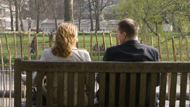 A couple sat on a park bench