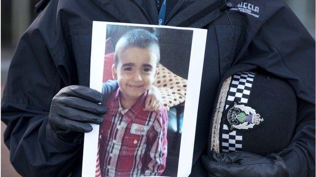 Superintendent Liz McAinsh holds a photo of missing child Mikaeel Kular