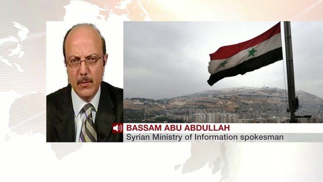 A photo of Bassam Abu Abdullah and a Syrian flag