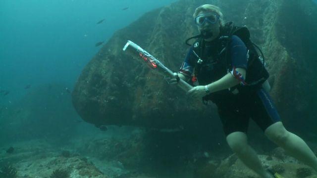 The Queen's baton underwater in the Seychelles