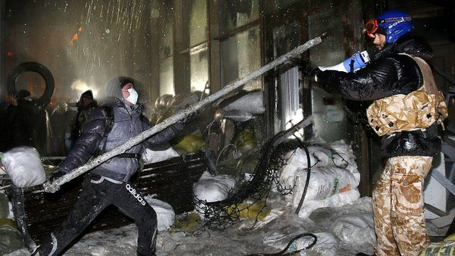 Protesters attack a government building in central Kiev, Ukraine, on 26 January
