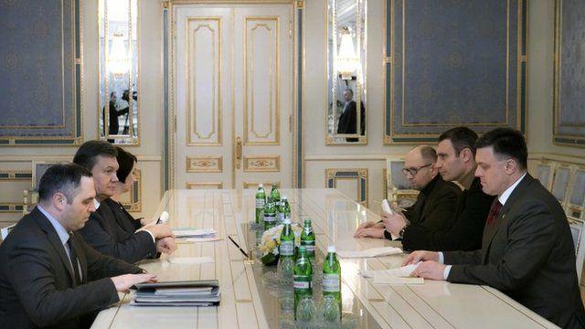 Ukraine's President Viktor Yanukovych, second left, talks to opposition leaders in Kiev