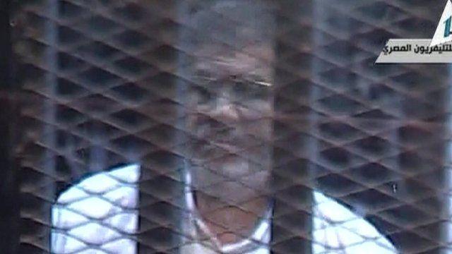 Mohammed Morsi at his trial