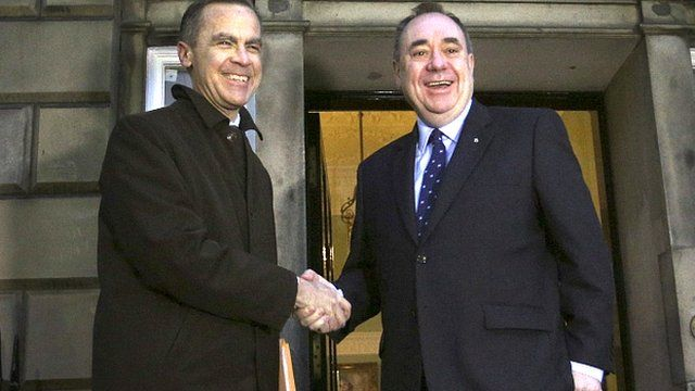 Bank of England governor Mark Carney, left, meets Scottish First Minister Alex Salmond as he arrives at Bute House in Edinburgh