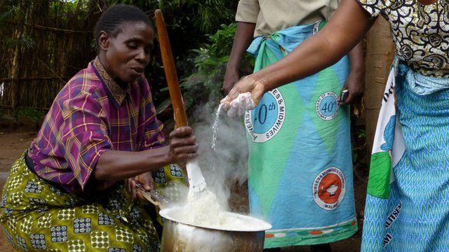 Women in Malawi prepare lunch