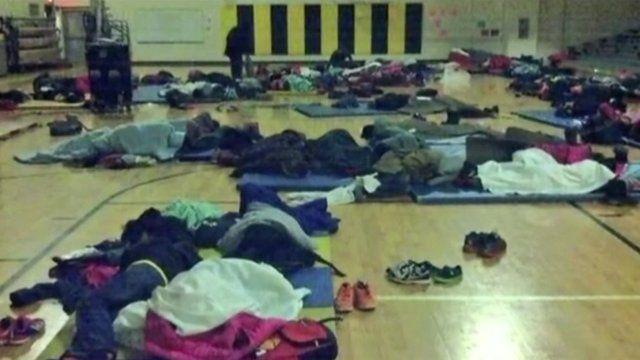 Children sleeping in their school gym, Atlanta