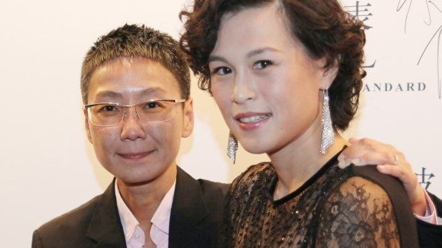Gigi Chao, right, daughter of the Hong Kong property tycoon Cecil Chao, poses with her partner Sean Eav