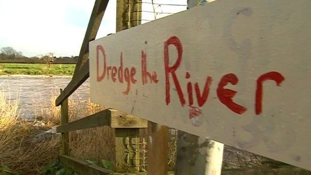 Dredge the river sign
