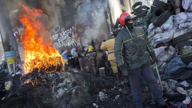 Protesters man a barricade in Kiev