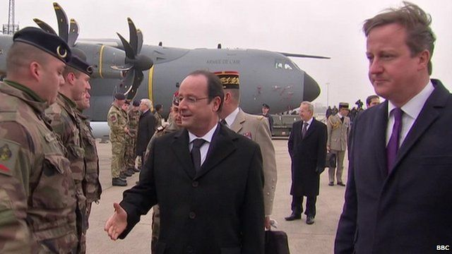 France's President Francois Hollande and British PM, David Cameron, at welcoming ceremony at RAF Brize Norton, Oxfordshire