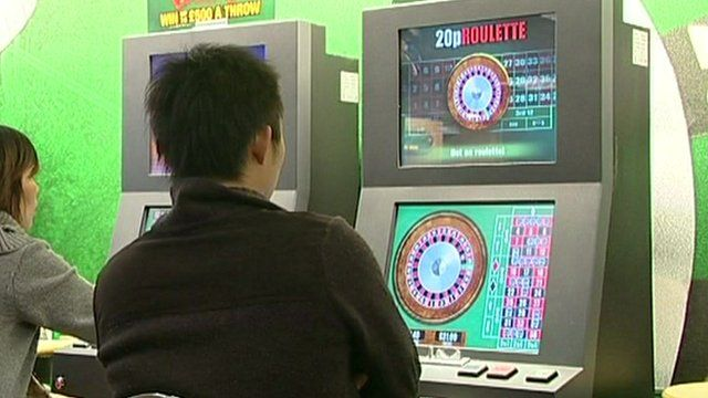 Man on a roulette machine
