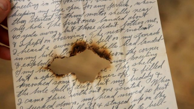 WWII letter with bullet hole through it