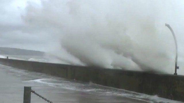Waves breach sea wall
