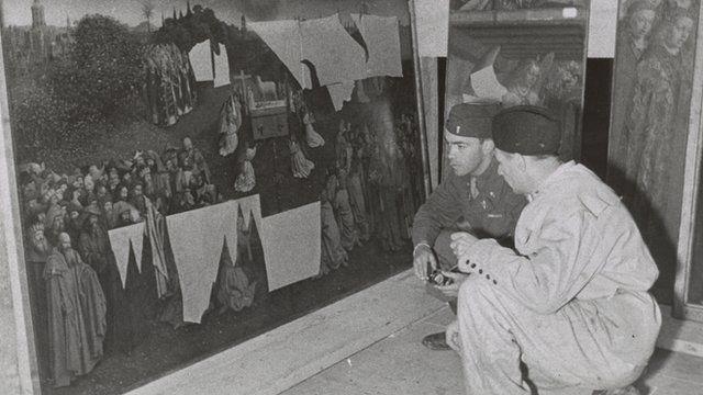 Lt Daniel J Kern and Karl Sieber examine the Ghent Altarpiece in the Altaussee mine, 1945