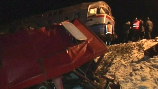 Wreckage of bus after train collision