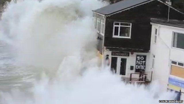 Wave crashing over restaurant