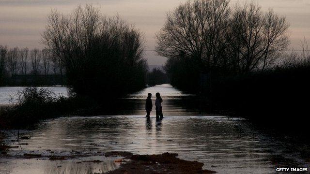 Children play in flood water at Burrowbridge