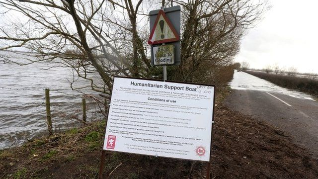 Information sign on flooded road