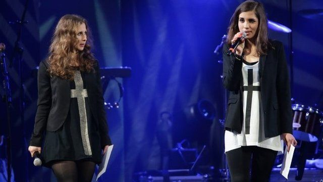 Maria Alyokhina (L) and Nadezhda Tolokonnikova of Pussy Riot speak onstage at the Amnesty International Concert presented by the CBGB Festival at Barclays Center 5 February 2014