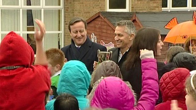 David Cameron and Gary Lineker with trophy at school sports event