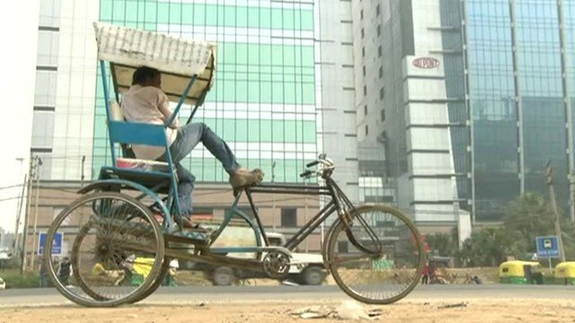 traditional bicycle in front of office blocks