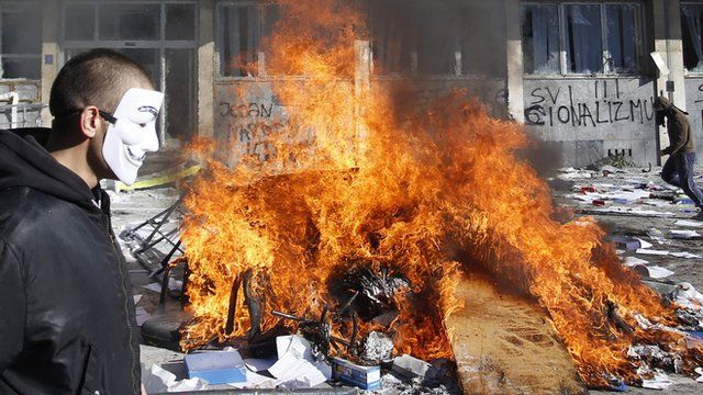 Protestors burn documents from a government building in Tuzla, Bosnia